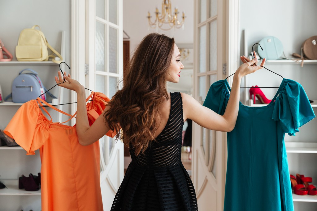 Woman choosing the right kind of color for her dress